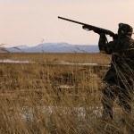 bigstock-Hunter-With-Rifle-1488909